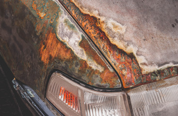 Background old car corroded rusty metal wall painted  background with metal rust stains, rust car, rust stains .