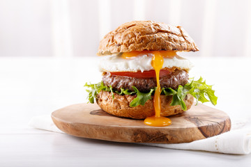 Close-up of beef burger on white background.