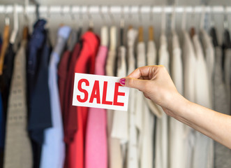 33998eff0d086 Female customer browsing clothes in a shop or outlet. Woman shopping ...