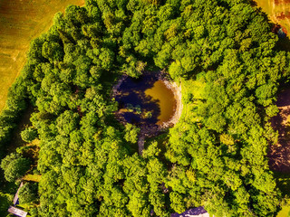 Fototapeta Saarema Island, Estonia: aerial top view the main meteorite crater in the village of Kaali in the summer