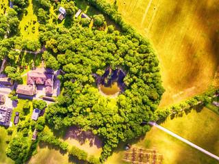 Saarema Island, Estonia: aerial top view the main meteorite crater in the village of Kaali in the summer