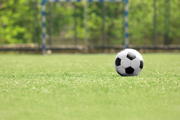 Soccer ball on green grass at the stadium