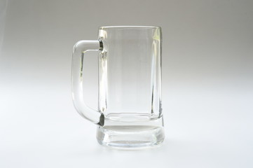 Empty glass for drinks on gray background
