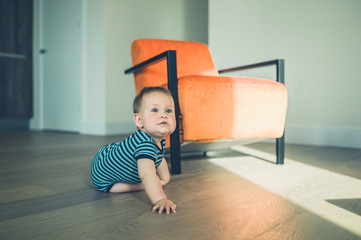 Cute little baby crawling in apartment