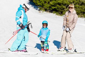 Family on a ski slope