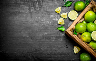 Fresh limes in the old box. Wall mural