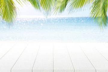 Empty top of wooden floor foreground on horizon tropical beach.For product display