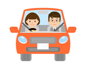 自動車を運転する夫婦