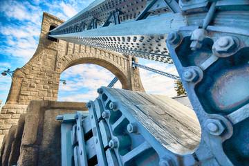WROCLAW, POLAND - AUGUST 14, 2017: Grunwald Bridge (Most Grunwaldzki) is a suspension bridge over the river Oder in Wroclaw, built between 1908 - 1910. Designed by Richard Pluddemann.