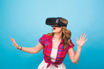 Happy young woman using a virtual reality headset.