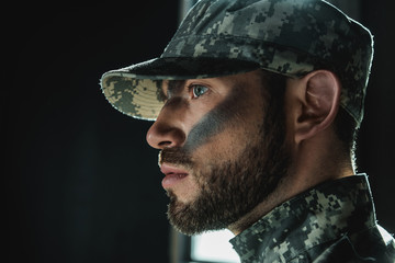 soldier with camouflage on face