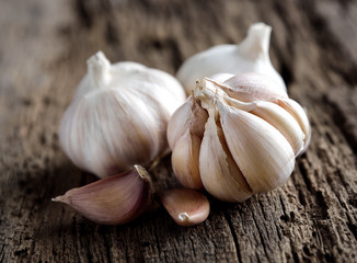 Garlic cloves on wooden vintage background.