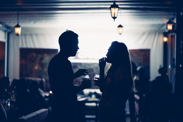 Couple having drinks in cafe