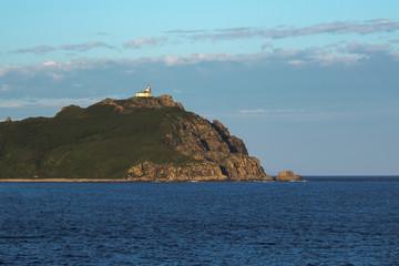 an abandoned lighthouse on a rocky promontory