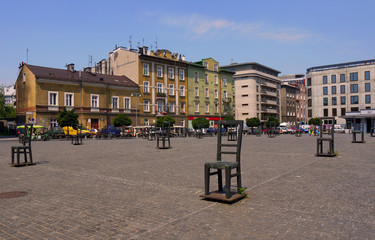 Krakow stock image. Jewish memorial Krakow. Jewish Ghetto in Krakow. Each chair represents Krakow Jews that were sent to Aushwitz