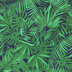Seamless pattern with tropical palm leaves. Green exotic background.
