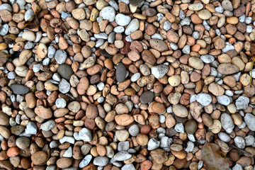 a texture or design of small stones, Stone background.