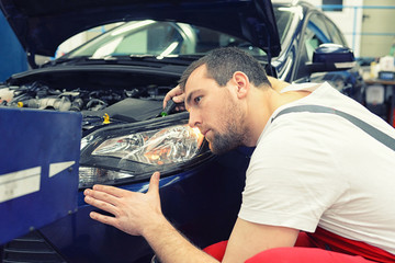 Adjust car-headlights by mechanic // einstellen Scheinwerfer durch Mechaniker in einer Autowerkstatt