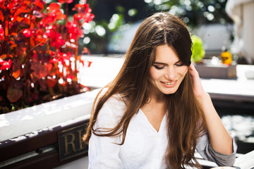 Charming brunette with long shiny hair