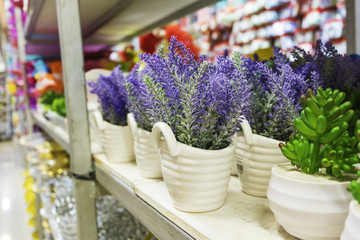 Artificial lavender plant in pot display on rack for sale.ideal for florist and decoration business