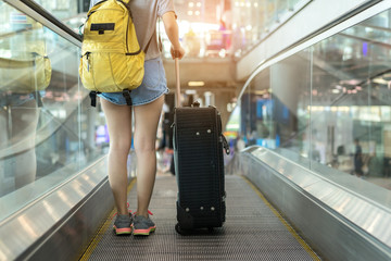 Young girl asian traveler walking with carrying hold suitcase luggage and passenger for tour travel booking ticket flight in airport international vacation time in holiday rest and relaxation.