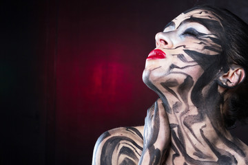 The painted woman with black smears with red lipstick on her lips raised her head upwards.