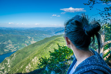 A girl looks to the National Park landscape.