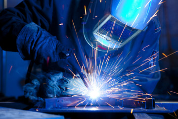 Welder erecting technical steel