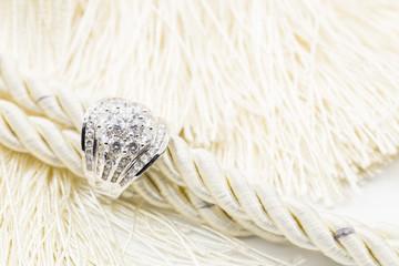 Diamond wedding rings on the white yarn. selective focus