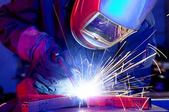 Welder erecting technical steel