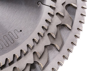 circular saws with teeth close-up, on a white