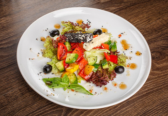 Traditional greek salad with fresh vegetables. Restaurant healthy food