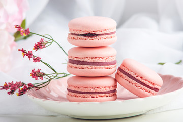 Deurstickers Dessert Pink strawberry macarons. French delicate dessert for Breakfast