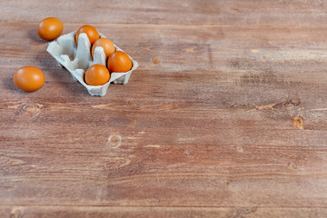 Fresh eggs on wood background. Copy space. Top view