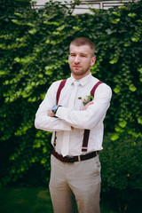 Portrait of the groom on a wedding day walk