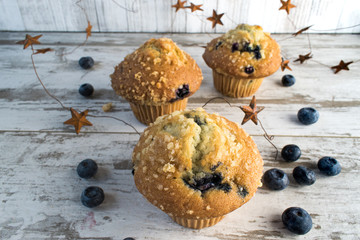 blueberry muffins and stars in rustic setting