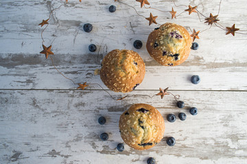 top view blueberry muffins and stars in rustic setting