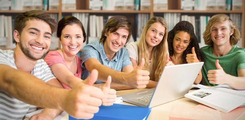 Composite image of college students gesturing thumbs up in libra