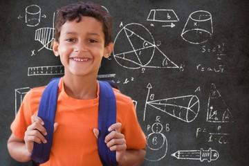 Composite image of portrait of smiling boy