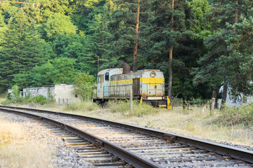 old soviet locomotive near the railway