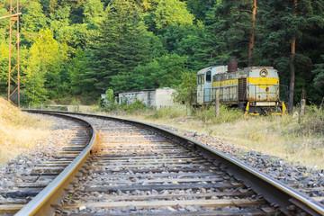 Diesel soviet locomotive on the railroad