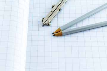 Drafting Compass and pencil on paper background