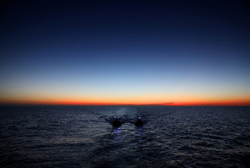 Two RHIB's are towed by the former fishing trawler Golf Azzurro, operated the Spanish NGO Proactive Open Arms, during a Search and Rescue mission for migrants trying to reach Europe in central Mediterranean Sea some 50 miles off the Libyan coast