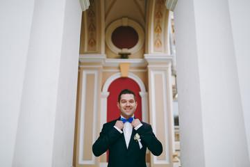 Portrait of the groom on a wedding day walk