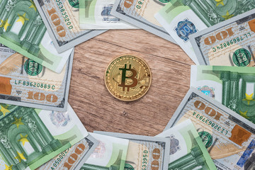 gold bitcoin with euro and dollar bills