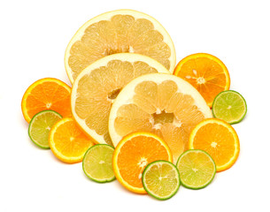 Fruit of citrus orange, lime and pomelo sliced isolated on white background. A healthy and nutritious food for health after training in sports for burning fat. Flat lay, top view