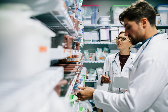 Pharmacists checking inventory at hospital pharmacy