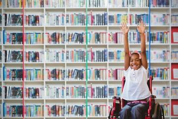 Composite image of girl in wheelchair in school corridor