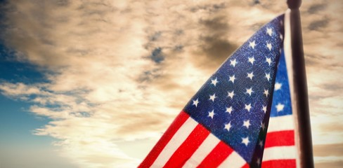 Composite image of american flag over white background