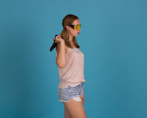 Young pretty girl with weapon, studio